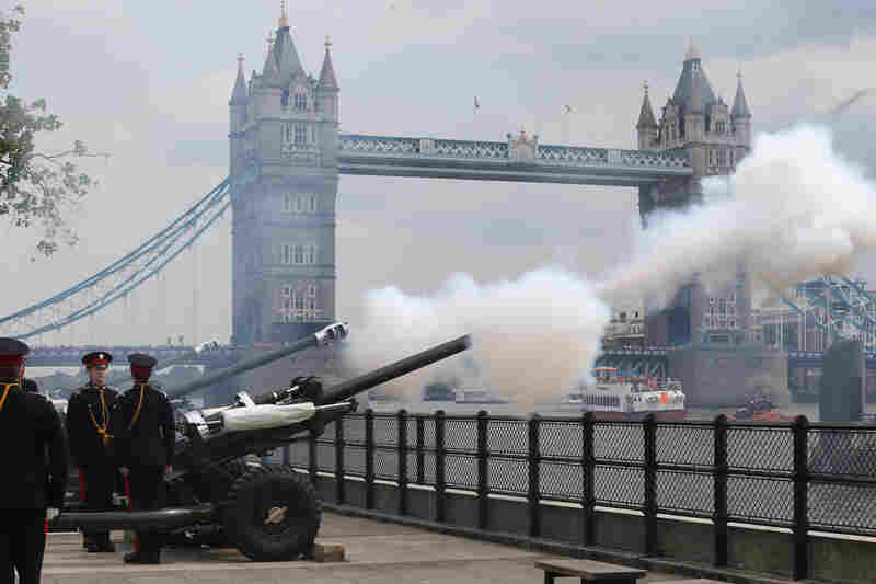 The Honourable Artillery Company fires a 62-round royal gun salute outside the Tower of London.