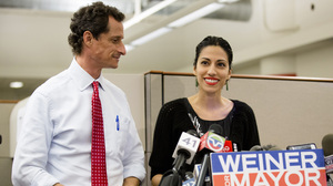 Huma Abedin, alongside her husband, New York mayoral candidate Anthony Weiner, speaks during a news conference at the Gay Men's Health Crisis headquarters in New York City on Tuesday.