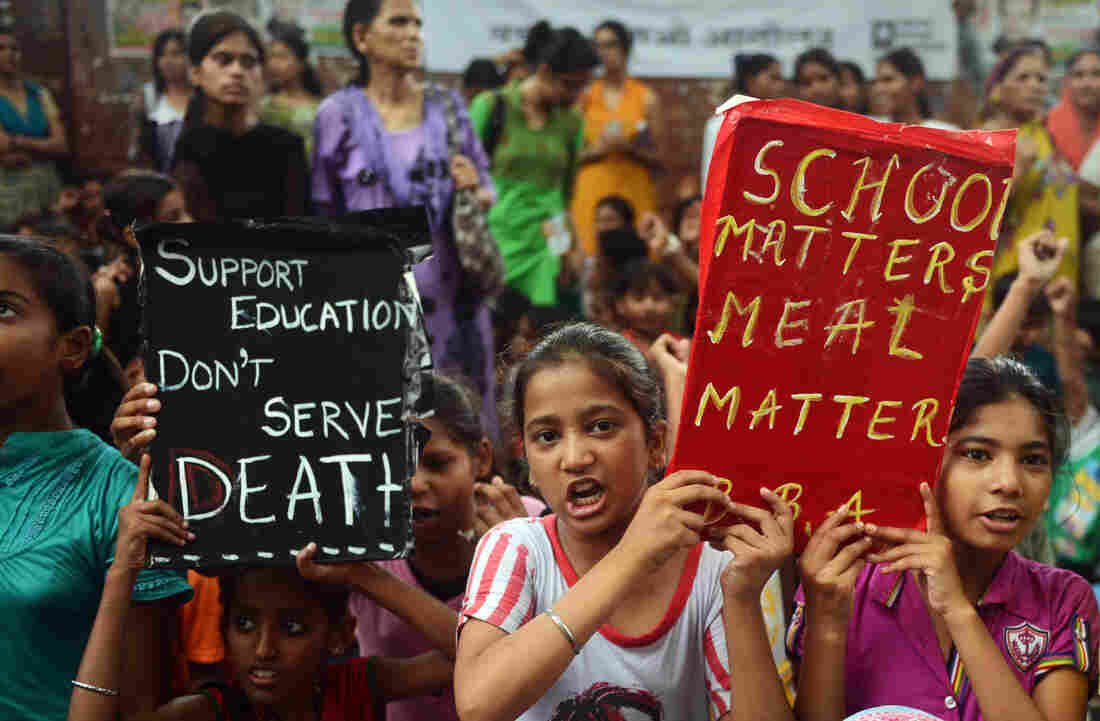 """Indian children and activists shout anti-government slogans on Saturday as they march to parliament demonstrating against the death of 23 children in Bihar state after they ate poisoned """"midday meals."""""""