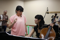 Composer Magda Giannikou works out a rhythm with Kronos cellist Sunny Jungin Yang.