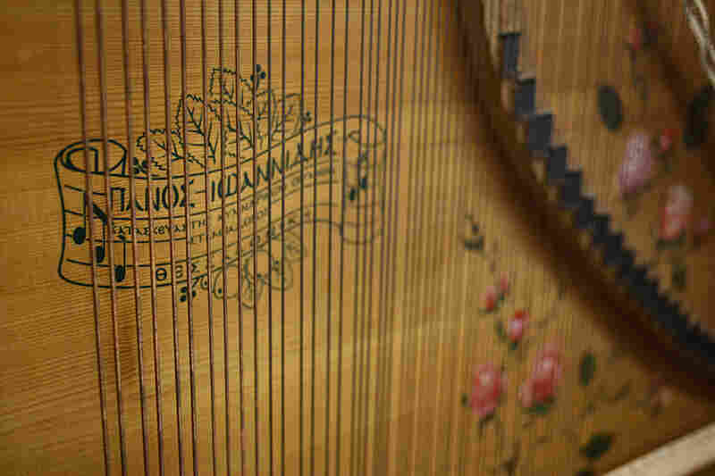 Part of the interior of Giannikou's laterna — an old Greek instrument that had faded out of use by World War II. It's something akin to an upright player piano, with thousands of little nails pinned into a small cylinder in its base. Each nail activates the strike of a string, creating one played note.