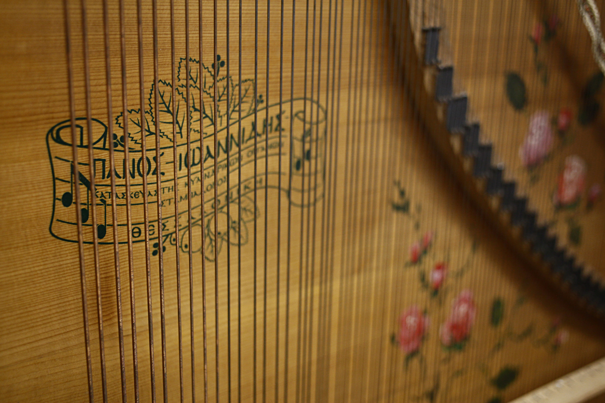 Part of the interior of Giannikou's laterna -- an old Greek instrument that had faded out of use by World War II. It's something akin to an upright player piano, with thousands of little nails pinned into a small cylinder in its base. Each nail activates the strike of a string, creating one played note.