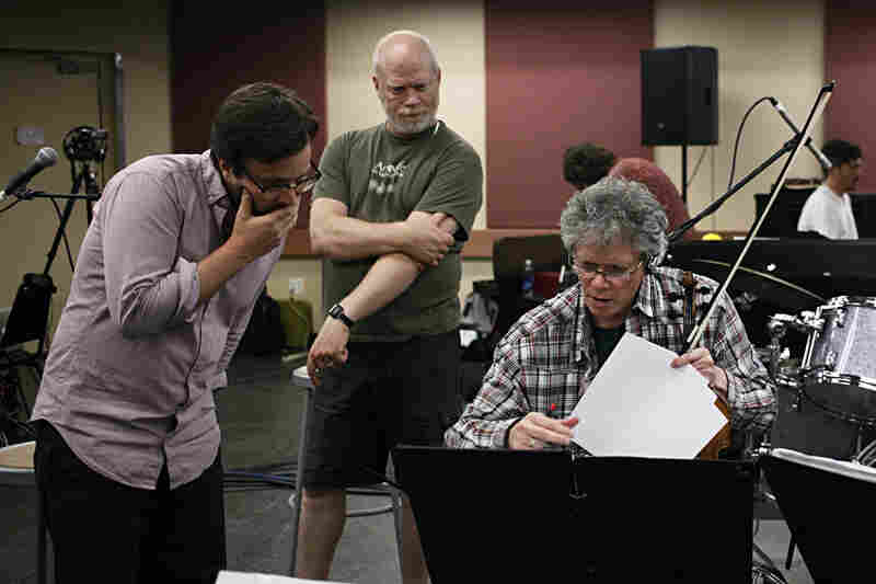 Red Hot + Fela! musical director Stuart Bogie, Kronos production director Laurence Neff and Harrington confer over details.