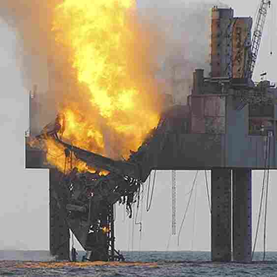 "An out-of-control natural gas well in the Gulf of Mexico continued to burn Wednesday after it blew out and caught fire. Beams supporting some of the ""Hercules 265 jack-up rig"" have collapsed."