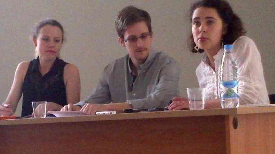 Edward Snowden, center, at Moscow's Sheremetyevo Airport on July 12. At left is WikiLeaks' Sarah Harrison.