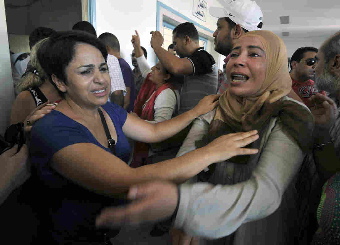 The sister of opposition politician Mohamed Brahmi, mourns at the hospital in Ariana, outside Tunis, after he was gunned down in front of his home, on Thursday.