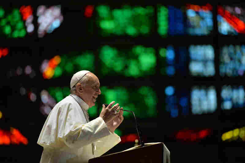 Pope Francis speaks to youths at the Metropolitan Cathedral of Rio de Janeiro on Thursday. He urged them not to despair as he addressed Brazil's political problems in the wake of massive protests. The pope is in Brazil for his first foreign trip since he became leader of the Catholic Church.