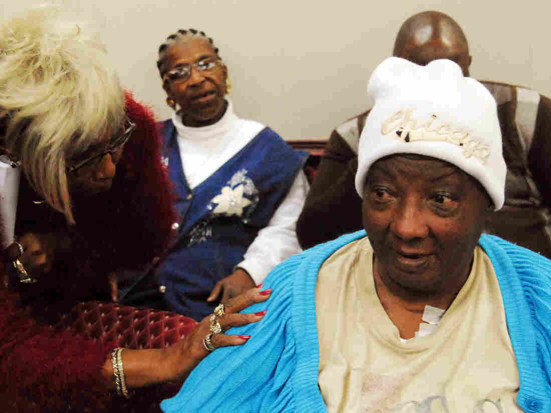 Sterilization victim Lela Dunston, 63 (seated front), following a meeting of the Governor's Eugenics Compensation Task Force in North Carolina in 2012.