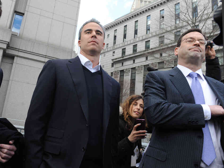 Former SAC portfolio manager Michael Steinberg (center) exits a Manhattan federal court with his attorney after his indictment on securities fraud charges in March.