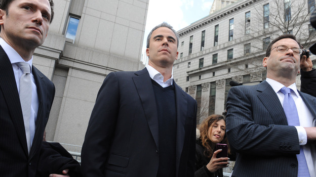 Former SAC portfolio manager Michael Steinberg (center) exits a Manhattan federal court with his attorney after his indictment on securities fraud charges in March. (AP)
