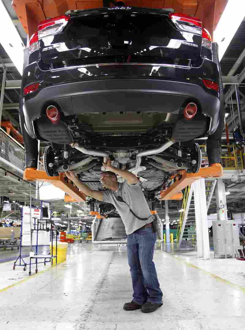 Jeff Caldwell, a chassis assembly line supervisor, checks a vehicle on the assembly line at the Chrysler Jefferson North Assembly plant in Detroit on May 8.