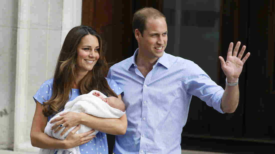 Britain's Prince William, right, and Kate, Duchess of Cambridge hold the Prince of Cambridge on Tuesday as they pose for photographers outside St. Mary's Hospital in London.