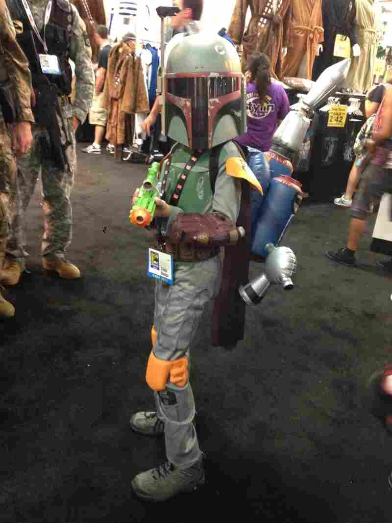 A child dresses up as Star Wars' Boba Fett.