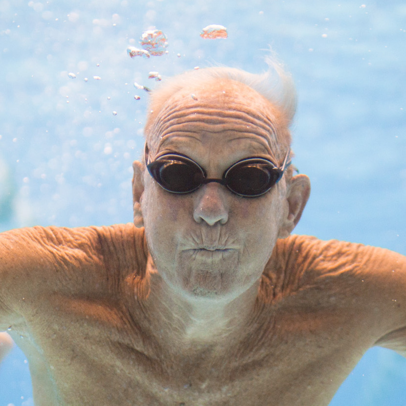 Graham Johnston, 82, poses for a portrait through an underwater window at the pool on Wednesday. Graham competed at the Senior Games in Cleveland, where more than 10,000 athletes older than 55 are competing in various sports.
