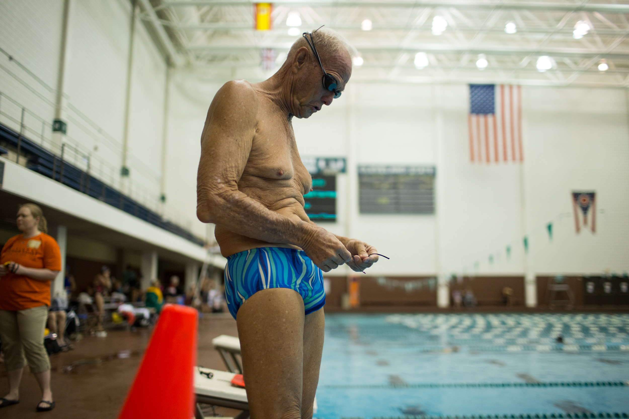 Johnston adjusts his suit before warming up for his events. He started swimming at the age of 2 and now practices five and sometimes six days a week.