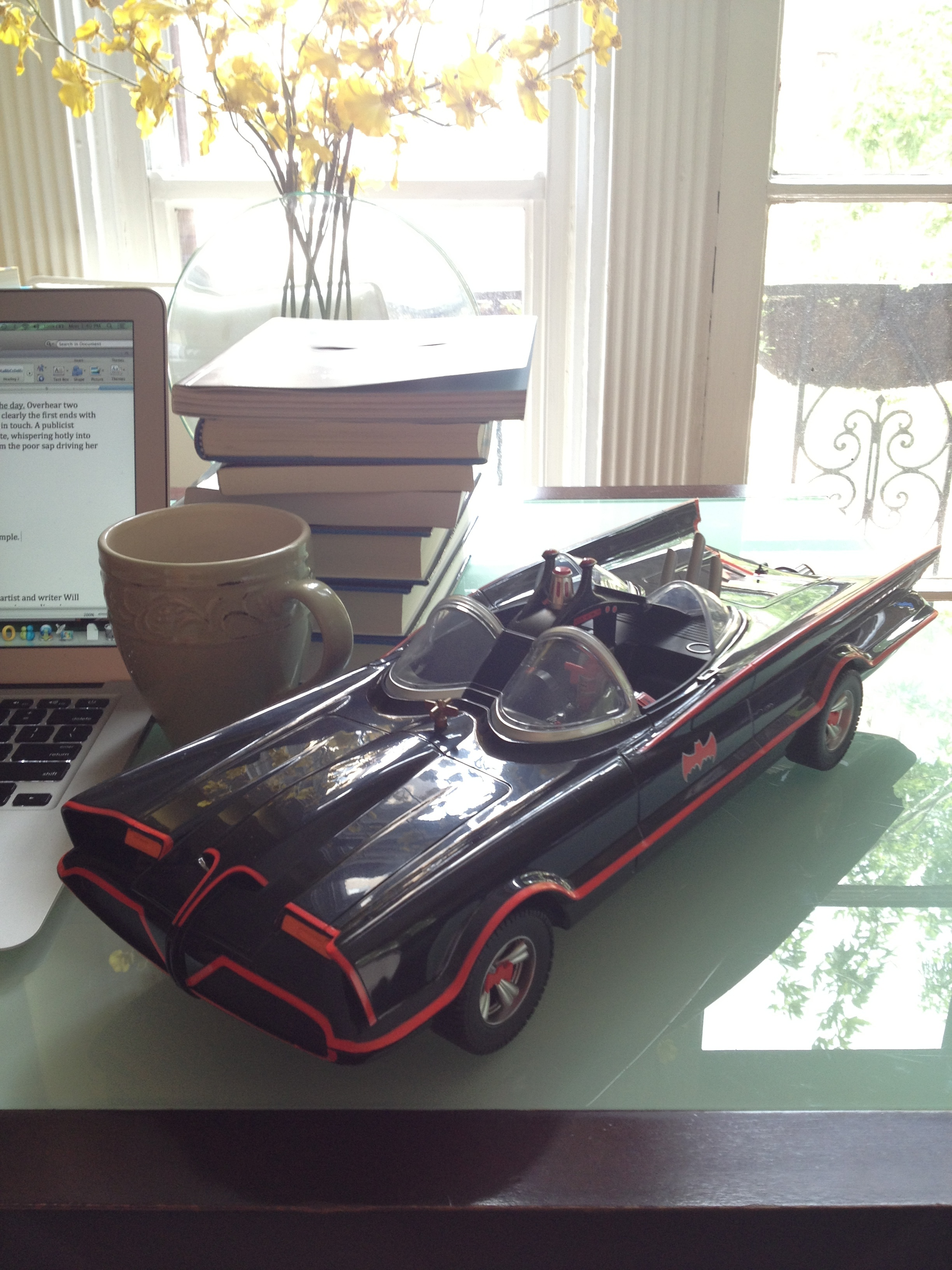 A model of the Batmobile from the 1960s live action Batman television show, starring Adam West and Burt Ward.