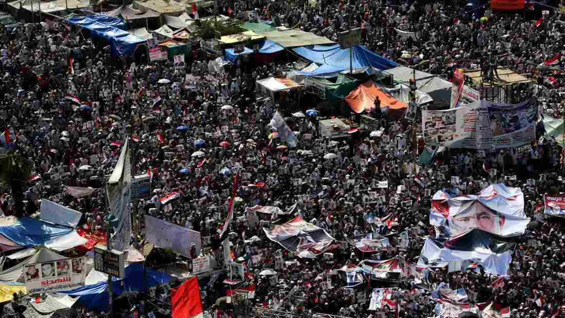 Muslim Brotherhood supporters of ousted President Mohammed Morsi attend a protest near Rabaa al-Adawiya mosque in Cairo on Friday.