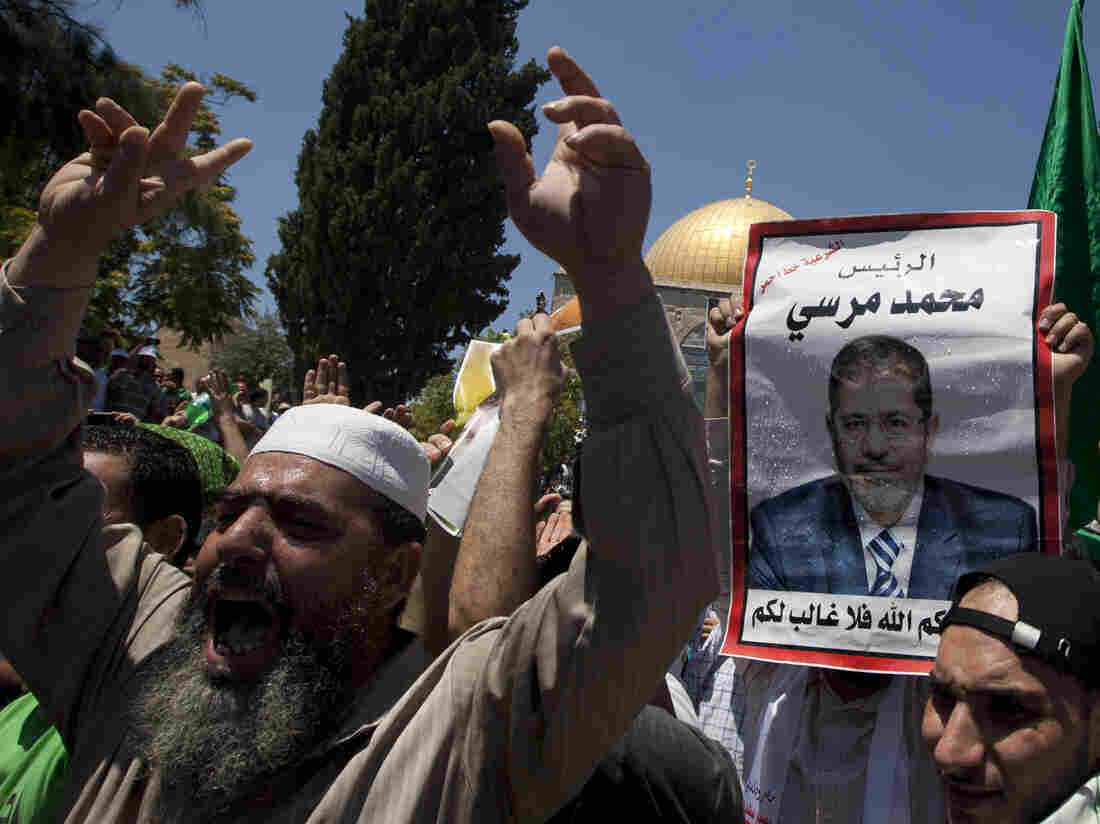 Supporters of deposed Egyptian President Mohamed Morsi attend a Friday rally in Cairo.