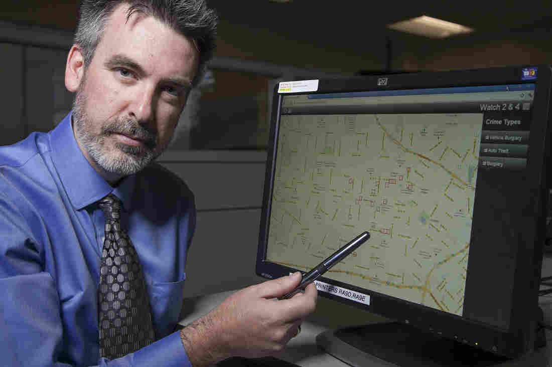"""Jeff Brantingham, creator of PredPol, demonstrates computer-generated """"predictive policing"""" zones at the Los Angeles Police Department Unified Command Post in Los Angeles last year."""