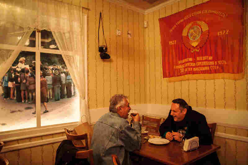 In the Back to USSR restaurant, photographs of previous times hang in the windows, January 2013.