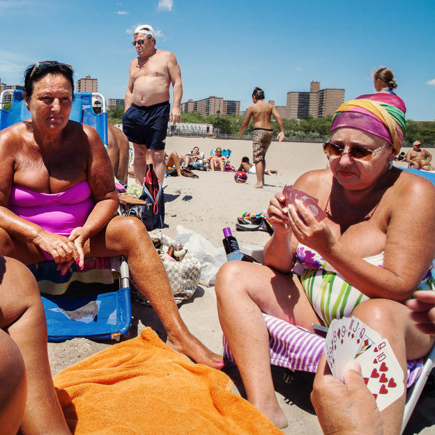 Ukrainian women from Odessa, Ukraine playing poker on the beach. June 16, 2012.
