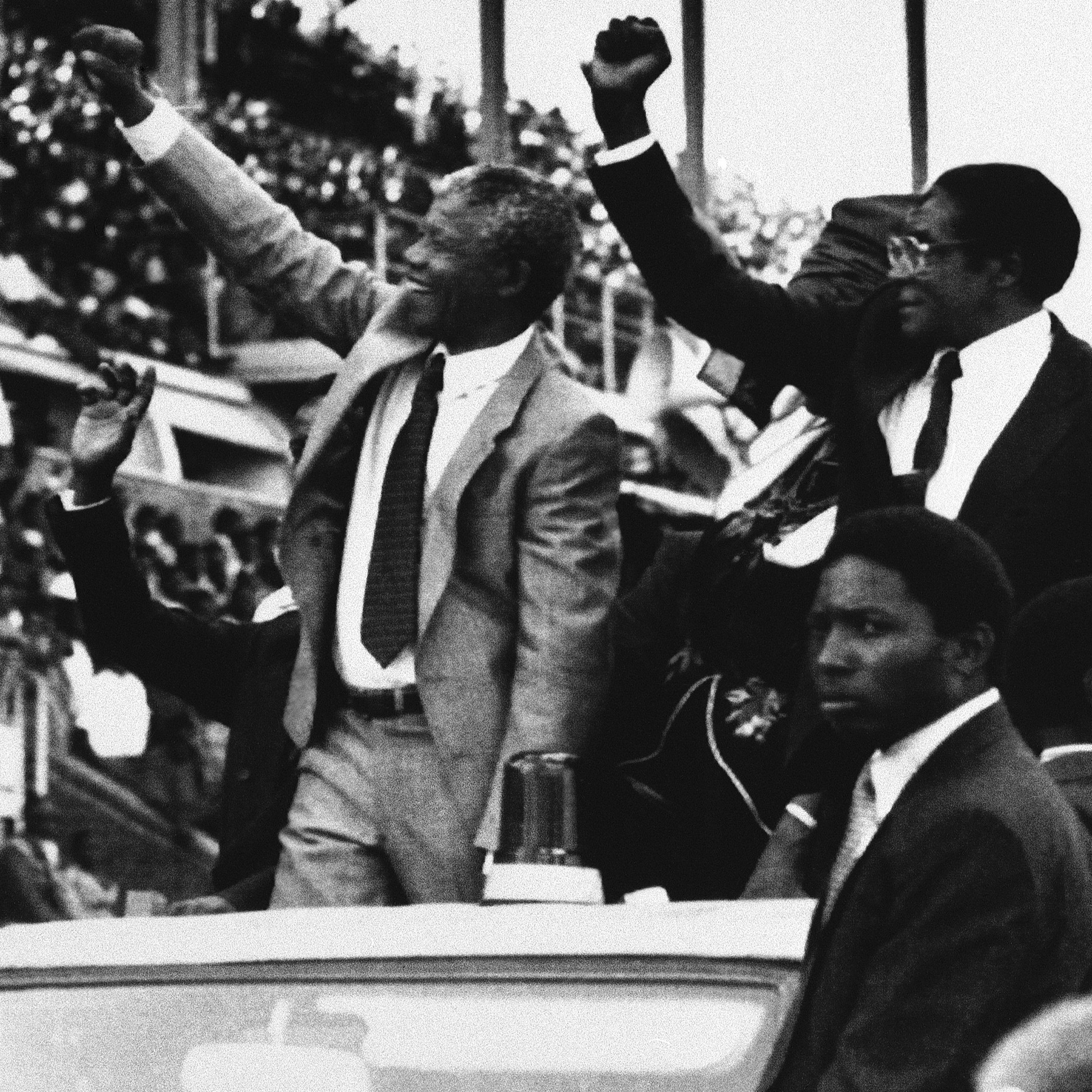 South Africa's Nelson Mandela, center, and Zimbabwe President Robert Mugabe, greet crowds in Harare, Zimbabwe, at the start of the new Zimbabwe public holiday, Mandela Day, March 5, 1990, Harare, Zimbabwe.