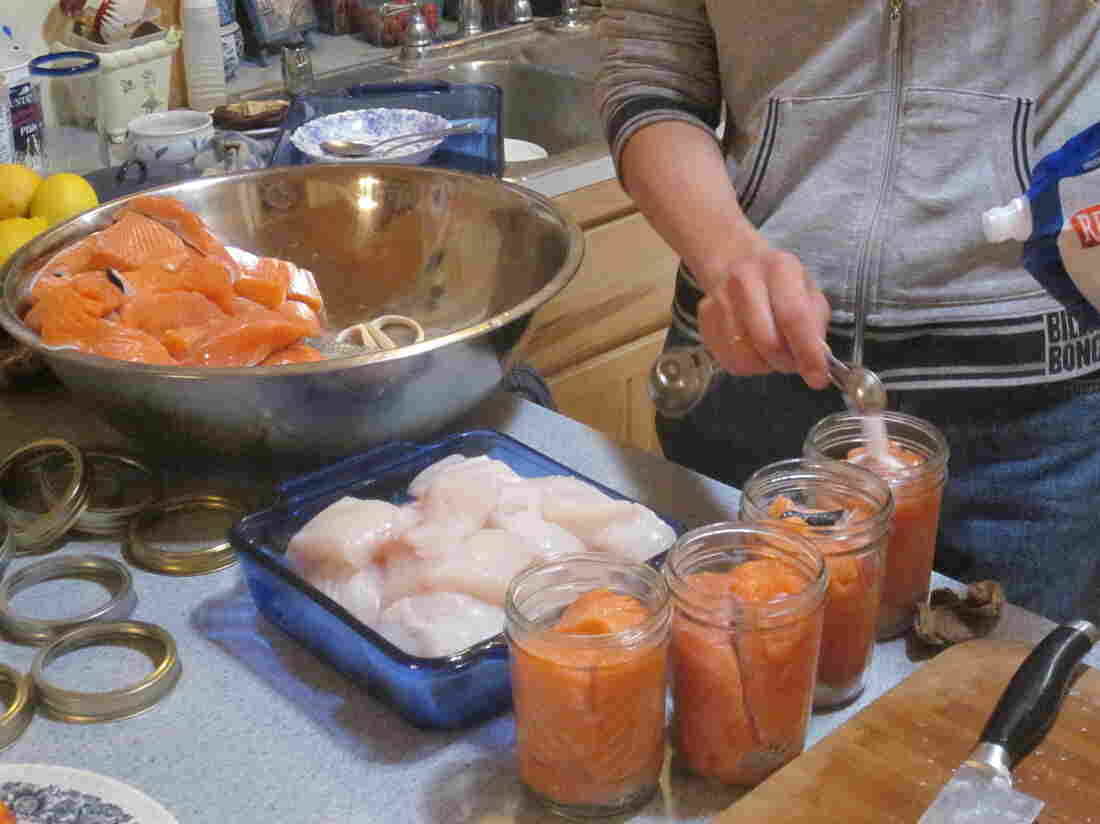 Jenny Wise, of South Thorne Bay, preps cuts of Coho salmon and Pacific halibut for canning.