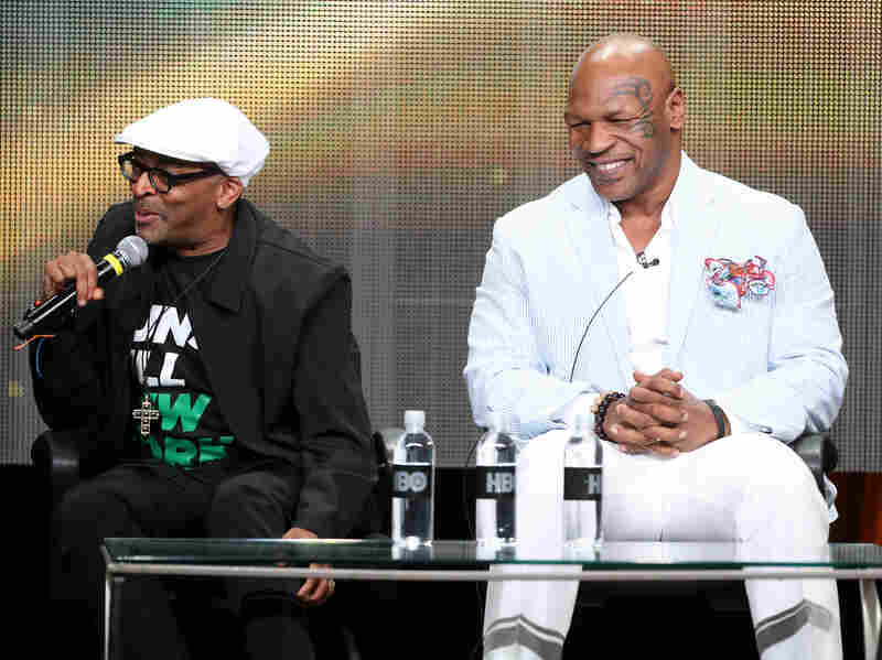 Director Spike Lee and Mike Tyson speak onstage at a panel in Beverly Hills on Thursday.
