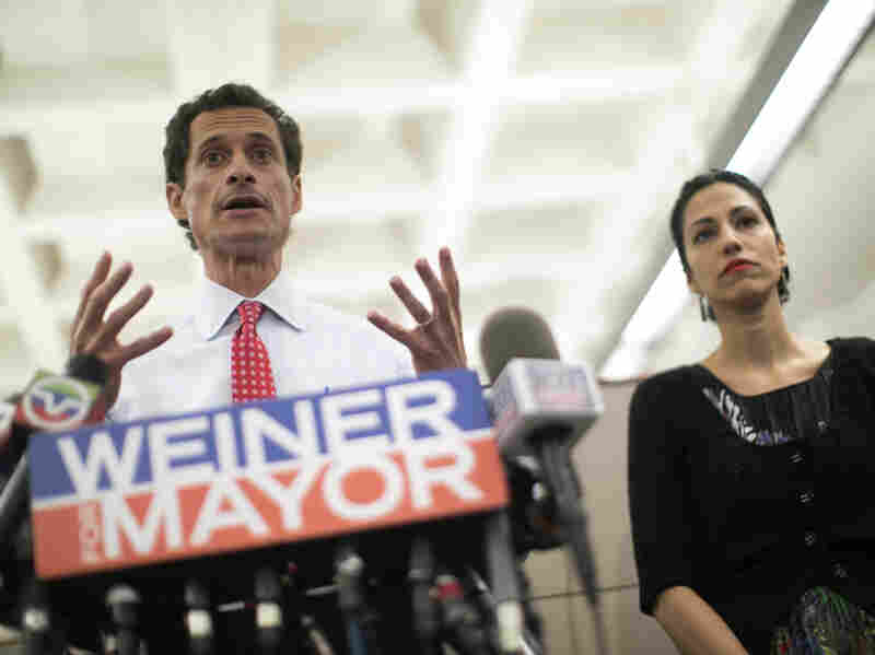 New York mayoral candidate Anthony Weiner, with his wife, Huma Abedin, at his side, says he will stay in the race despite admitting he sent newly revealed sexually explicit online chats and photos even after he resigned from Congress.