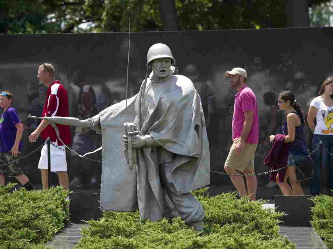 Tourists visit the Korean War Veteran Memorial on the National Mall on Friday.