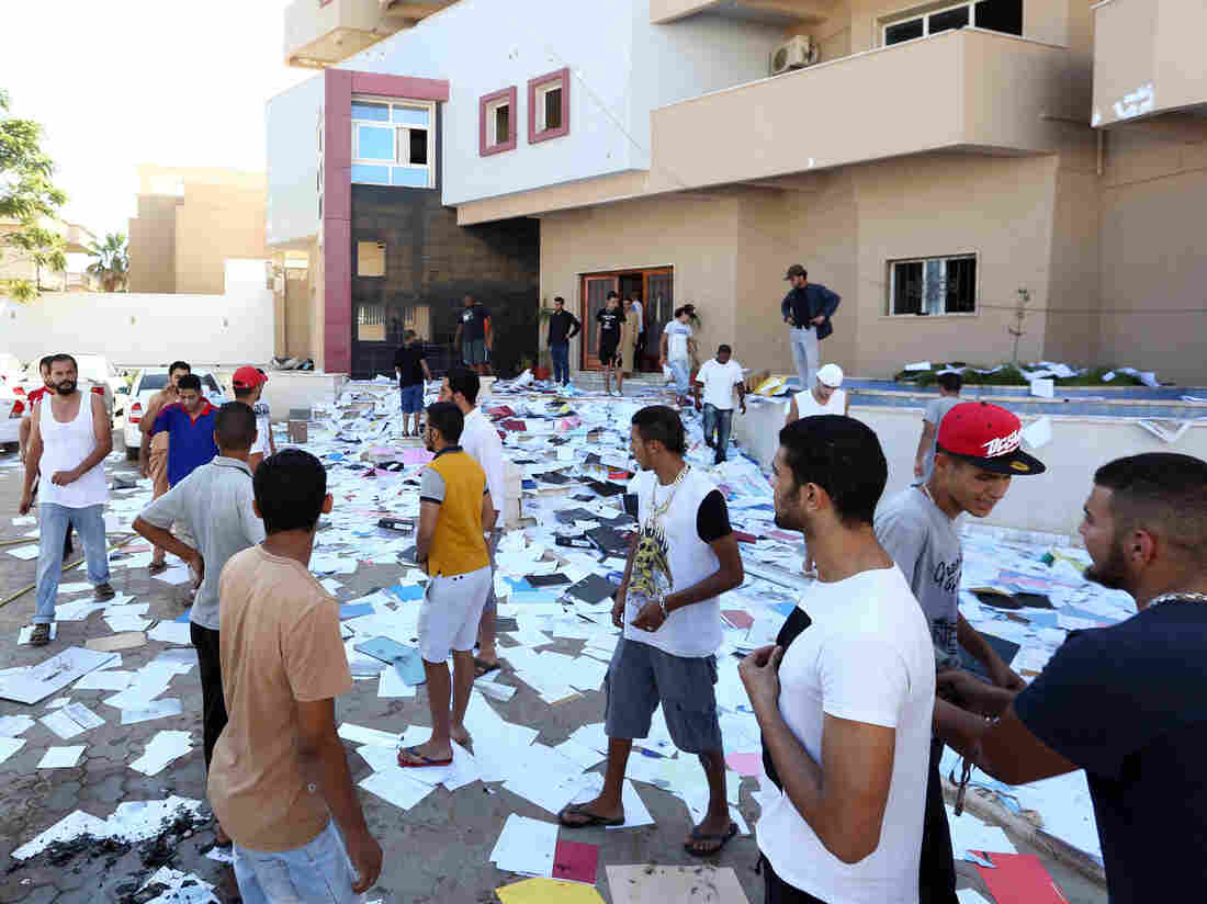 Libyan protesters shown after ransacking the offices of the Muslim Brotherhood-backed Party of Justice and Construction, in Tripoli on Saturday.