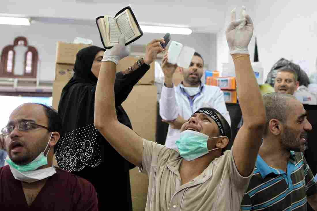 An Egyptian man mourns the death of a relative, shot dead after violence erupted Friday night, inside the Muslim Brotherhood field hospital in Cairo.