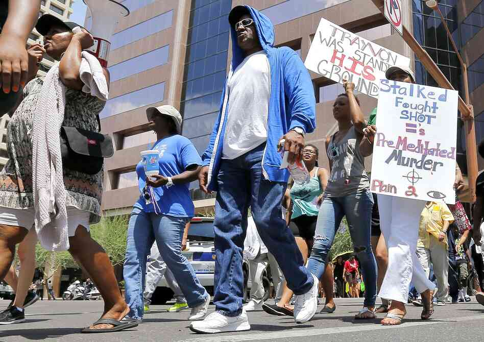 Marchers aligned with the Justice for Trayvon Martin movement called for a federal civil rights action to be filed against George Zimmerman in Phoenix on Monday. Zimmerman was found not guilty in the shooting death of Trayvon Mart