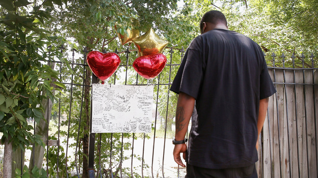 A sidewalk memorial in Chicago remembers Eugene Clark, 25, who was shot and killed last weekend. In the same weekend, the city had at least 6 people killed and 22 wounded by gunfire. This weekend, the Congressional Black Caucus held a summit in Chicago to discuss violence in urban areas. (Getty Images)