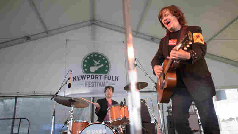 Members of the Mountain Goats perform live at the 2013 Newport Folk Festival.