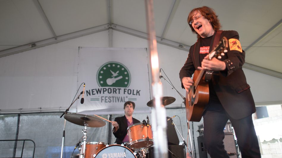 Members of the Mountain Goats perform live at the 2013 Newport Folk Festival. (NPR)