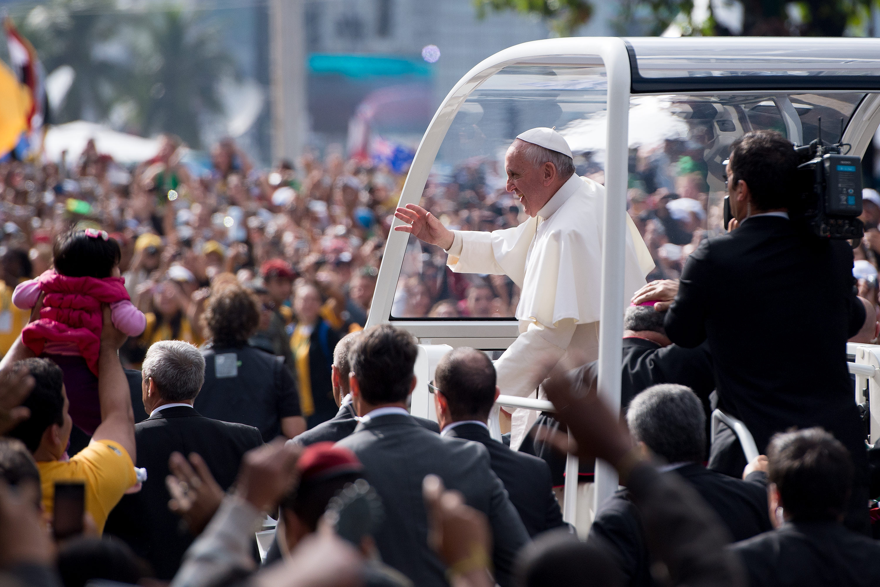 Pope Francis waves from the Popemobile as he heads to celebrate Mass for the Catholic Church's World Youth Day celebrations.