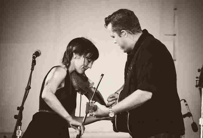 Jason Isbell (right) gives a powerful and profound live set with his wife Amanda Shires at Newport.