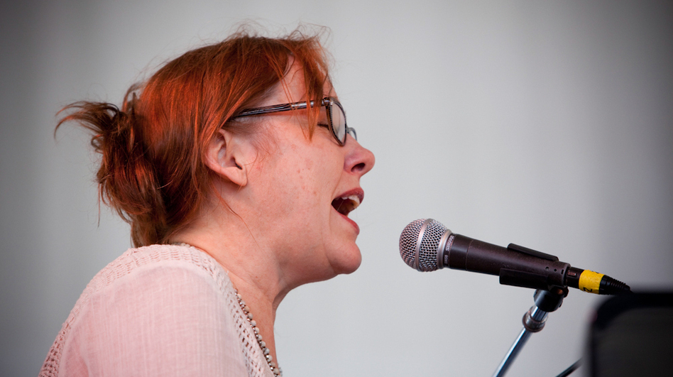 Iris Dement performs at the 2013 Newport Folk Festival. (NPR)