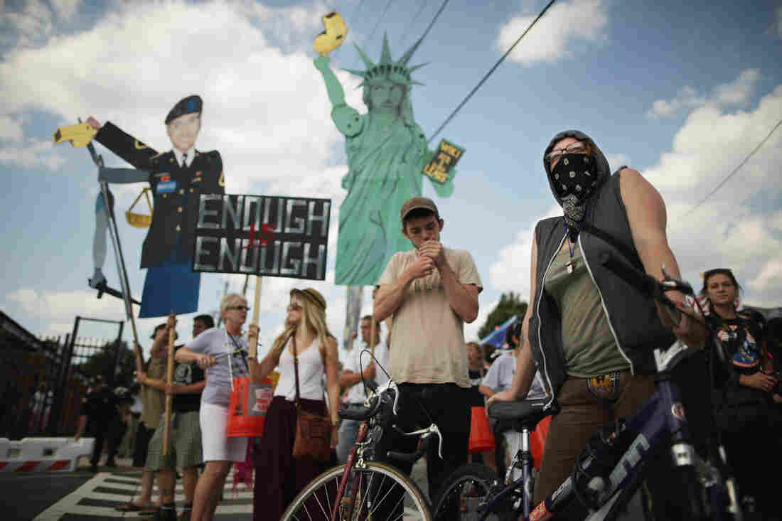 Supporters of U.S. Army Pfc. Bradley Manning protest his detention by marching around the perimeter and blocking the gates of Fort McNair in Washington, D.C., on the final day of closing arguments in his military trial Friday.