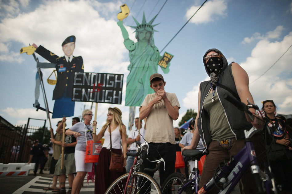 Supporters of U.S. Army Pfc. Bradley Manning protest his detention by marching around the perimeter and blocking the gates of Fort McNair in Washington, D.C., on the final day of closing arguments in his military trial Friday. (Chip Somodevilla/Getty Images)