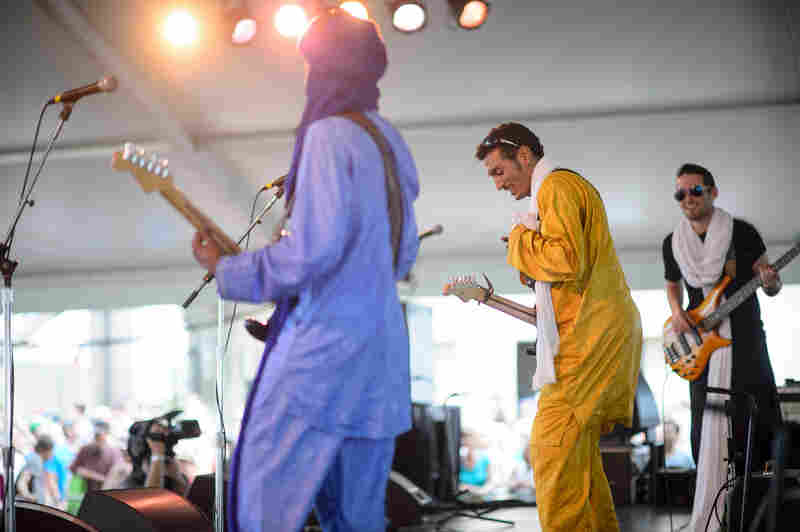 Bombino speaks several languages — none of them English — but his endlessly hypnotic Saharan rock puts the audience in a trance.