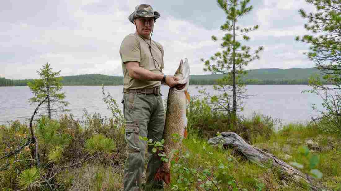 The Russian president holds a pike he caught July 20 while fishing in the Siberian Tyva region.