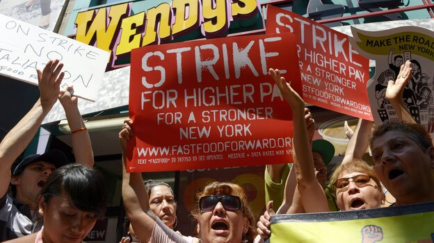 People gathered outside a Wendy's restaurant in New York City on Monday as part of a one-day strike calling for higher wages for fast-food workers. (EPA/Landov)
