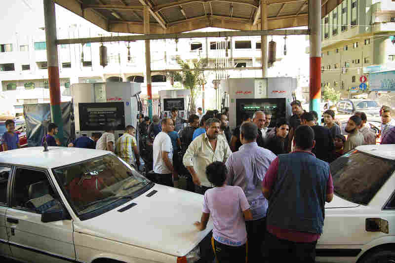 Gazans crowd a gas station selling Egyptian gas, which is cheaper than its Israeli counterpart. The Egyptian military has also sharply curtailed the smuggling of gas into Gaza via the tunnels.