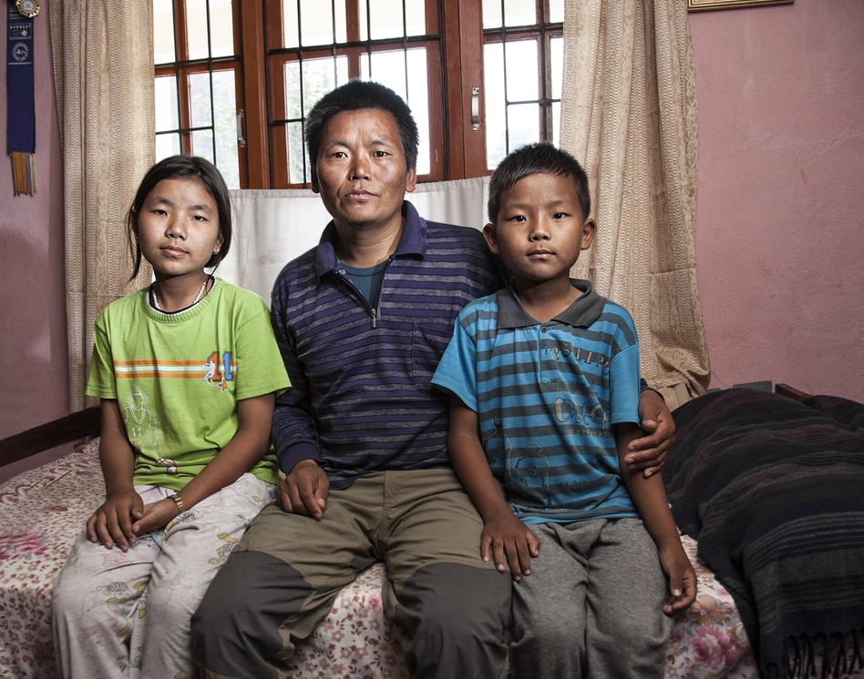 Despite a compound fracture in his ankle from July 2012, Lhakpa Rangdu returned to Everest's summit this past spring to earn money for his children Chhoki (left), 12, and Mingma, 9. (Courtesy of Grayson Schaffer)