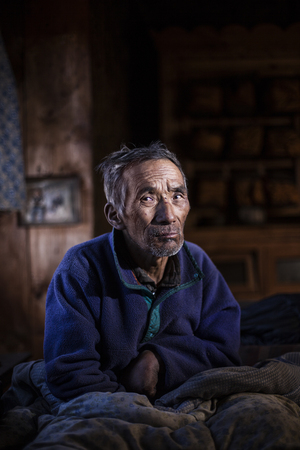 High-altitude stroke victim Lhakpa Gyalzen lives alone in the village of Phortse, Nepal. The region's highest-ranking holy man told him to read 100,000 pages of Buddhist script to heal himself.