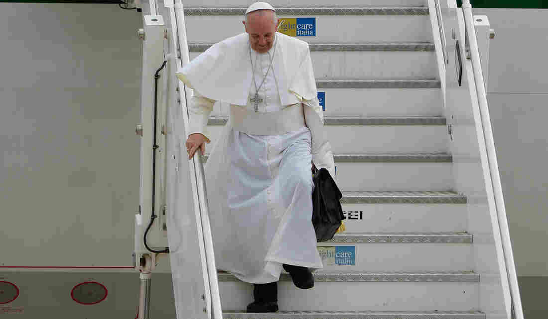 Pope Francis returned to Rome on Monday after his trip to Brazil. The flight included a news conference in which the pope struck a conciliatory tone about gay Catholics. He also explained what he keeps in his black bag.