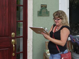 Volunteer Tammy Spencer goes door to door in Boca Raton., Fla., on July 27 to spread the word on the state's health exchange.