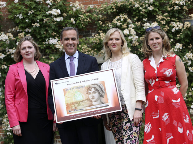 Parliament member Stella Creasy (second from right) and activist Caroline Criado-Perez (right) pose with a mock-up of the new 10-pound banknote featuring Jane Austen.